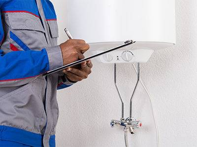 Plumber-in-front-of-water-heater